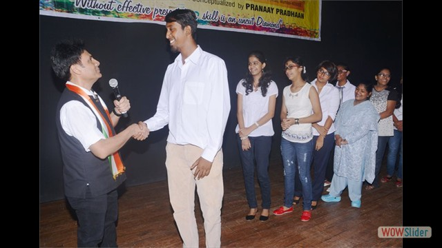 Student Mr.Prasad Rane handshaking with Mr.Gautam Garry Guptaa