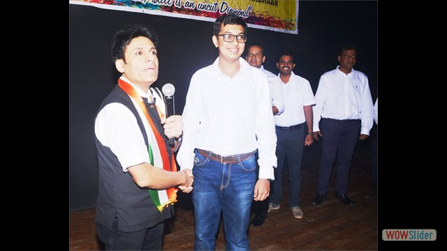 Student Mr.Karan Dharamshil Handshaking with Mr.Gautam Garry Guptaa